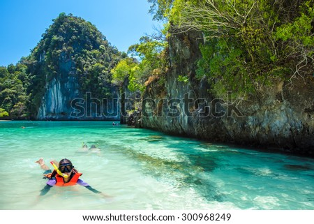 Asia Young lady snorkeling in Tropical beach scenery, Andaman sea, View of koh hong island krabi,Thailand - Shutterstock ID 300968249