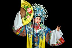 Asian actor singing a Beijing opera with a fan