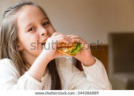 Asian American girl eating burger #344386889