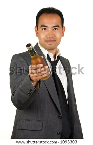 Asian American man in a suit holding a beer, offering it.