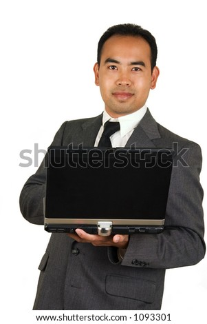 Asian American man in a suit standing with a Laptop.