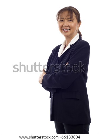 Asian American senior businesswoman standing with hands folded against white background