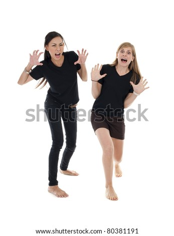 asian and caucasian woman with funny pose over white background