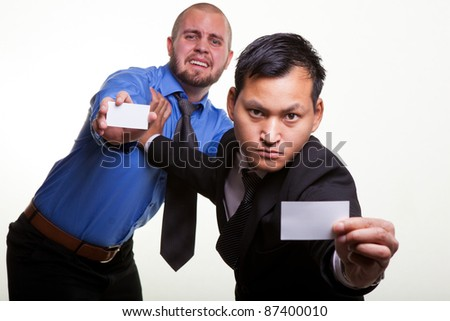 Asian and European  businessmen fighting to make business.