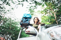 Asian attractive tourist woman holding a suitcase, Preparing for holiday travel, Standing on a pickup truck, to people and travel concept.