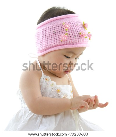 Asian baby girl playing with her hand
