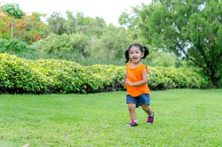 Asian baby girl smile and running in the garden