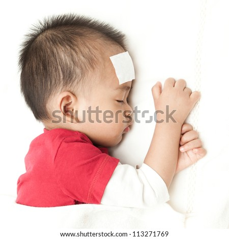 Asian baby sleeping and suffering fever heat