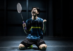 Asian badminton player is glad that he wins