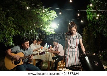 Asian barbecue party men are singing their friends.at night