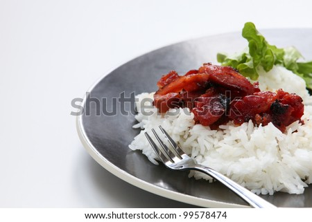 Asian barbecue pork on a bed of steamed rice.