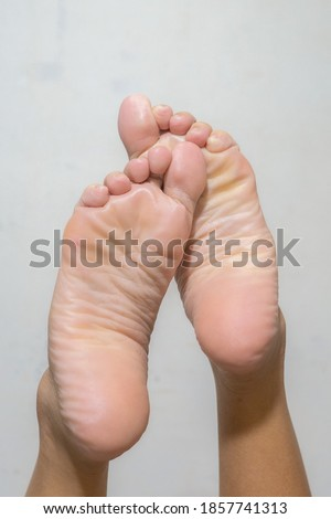 Asian Bare feet and unpolished natural nails