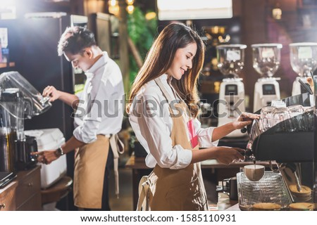 Asian Barista preparing cup of coffee, espresso with latte or cappuccino for customer order in coffee shop,making espresso, Small business owner and startup in coffee shop and restaurant concept