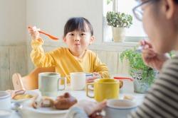 asian beautiful girl having breakfast