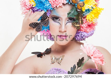 Asian Beautiful Girl With colorful make up with fresh Chrysanthemum Flowers  and Butterfly. Beauty Face ed5d7f59c