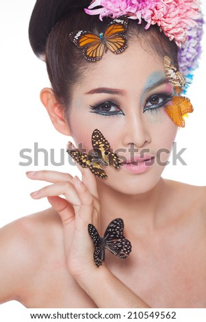 Asian Beautiful Girl With colorful make up with fresh Flowers and Butterfly.  Beauty Face 22894fdc5