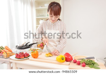 Asian beautiful woman w is being prepared for cooking in the kitchen.