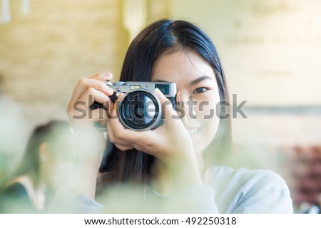 Asian beautuful women use camera totke photo forground blurred, Close up #492250318