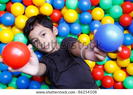 Asian boy and colorful small ball