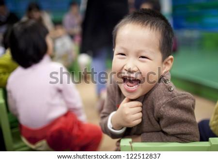 asian boy enjoying the preschool class in classroom