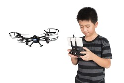 Asian boy holding hexacopter drone and radio remote control (controlling handset) for helicopter, drone or plane, studio shot isolated on white background.