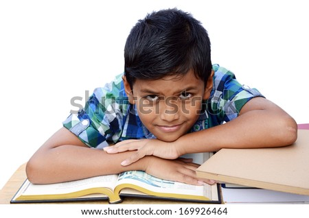 Asian boy in the classroom isolated on white background with clipping path.