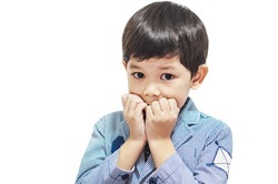 Asian boy is making emotion expression isolated over white