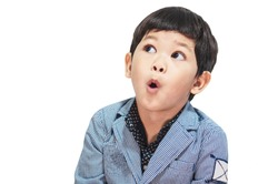 Asian boy is making expression isolated over white