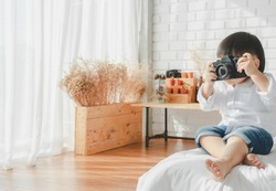 Asian Boy Japanese Children taking photo wearing white shirt on white bedroom in white room.To keep memories moment cuteness of Family lifestyle happy