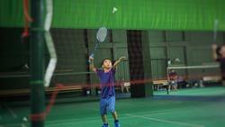 Asian boy playing badminton.(Selected focus)