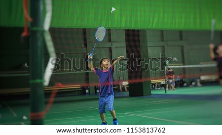Asian boy playing badminton.(Selected focus)
