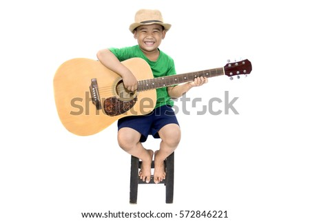 4be3244bf83de Happy young boy playing guitar Images and Stock Photos - Page  35 ...