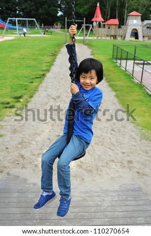 Asian boy playing on cable line