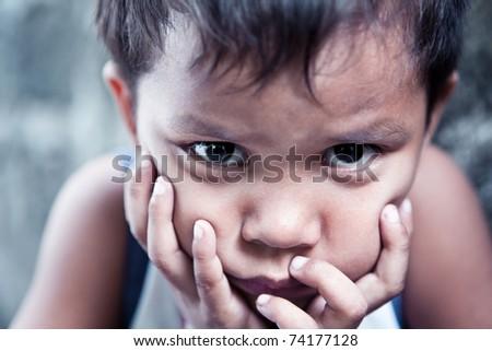 Asian boy portrait - Filipino child contemplating closeup, shallow depth of field