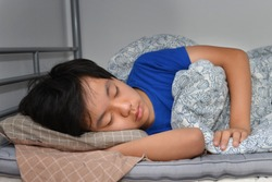 Asian boy sleeping