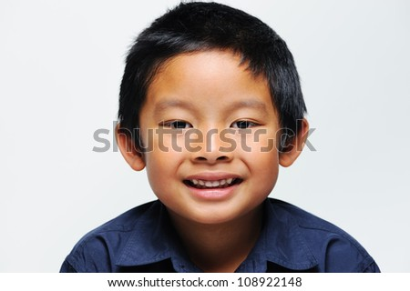 Asian boy smiling close up of face