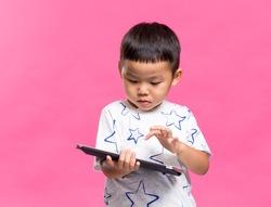 Asian boy using dgital tablet
