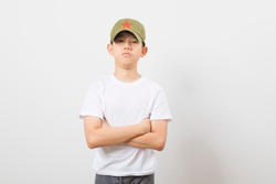 Asian boy wearing a Chinese Chairman Mao Zedong Communist Red Army Hat on white background.