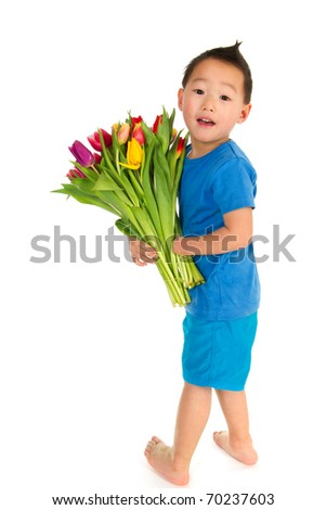Asian boy with light handicap and a colorful bouquet tulips