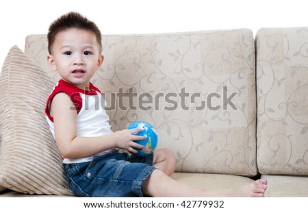 Asian boy with toy. Portrait of Asian little boy with globe toy.