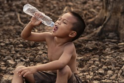 Asian boys are currently lacking clean water for consumption. concept climate change