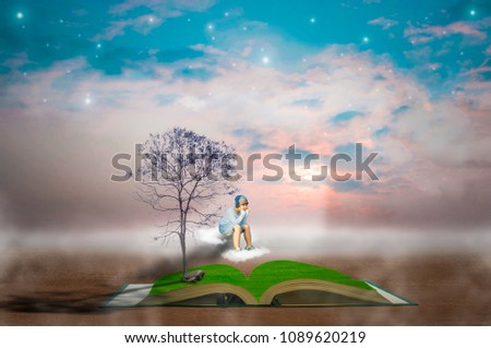Asian boys, trees, rocks, books, sky, clouds, and stars, The abstract concept, the book gives rise to an endless imagination.