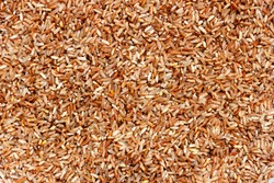 Asian bread. Brown tropical rice (refined grain with branny layer) from Sri Lanka. Healthy product. Rice background
