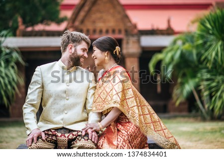 Asian bride and Caucasian groom have romantic time with Thailand dress #1374834401