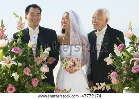 Asian Bride and Groom With Father