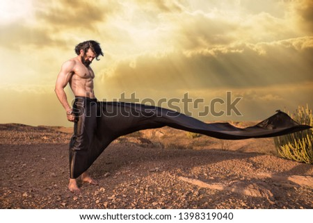 Asian brunette Young handsome muscled fit male model man posing outdoor showing his abdominal muscles cloth flying in air fantasy style - Image