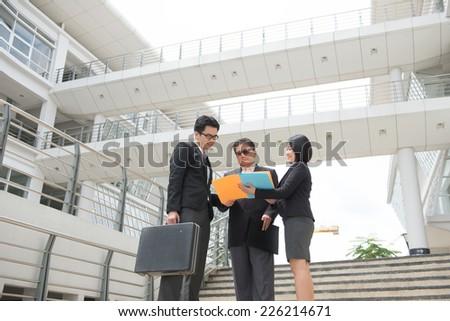 asian busines team outdoor meeting