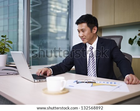 asian business executive working in office.