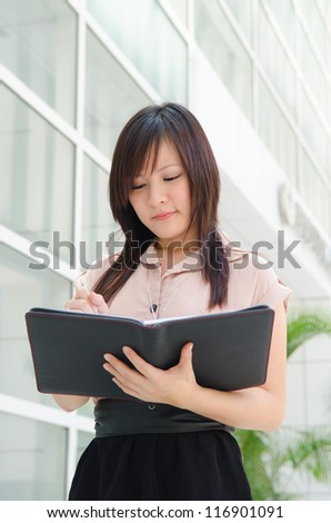 asian business girl with a notebook