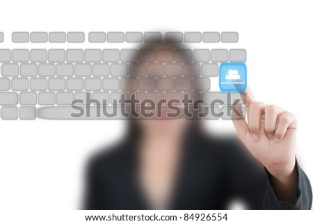 Asian business lady pushing keyboard for social network.
